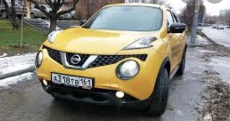 Новая машина Ниссан жук желтая